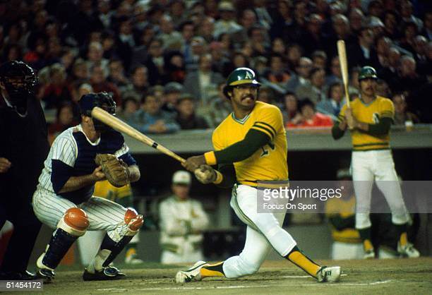 Outfielder Reggie Jackson of the Oakland Athletics swings hard against the New York Mets during the World Series at Shea Stadium on October 1973 in...