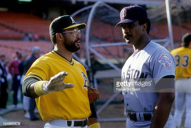 Outfielder Reggie Jackson of the Oakland Athletics talks with outfielder Jime Rice of the Boston Red Sox during batting practice prior to Major...