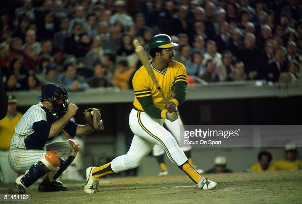 Outfielder Reggie Jackson of the Oakland Athletics watches his ball fly against the New York Mets during the World Series at Shea Stadium on October...