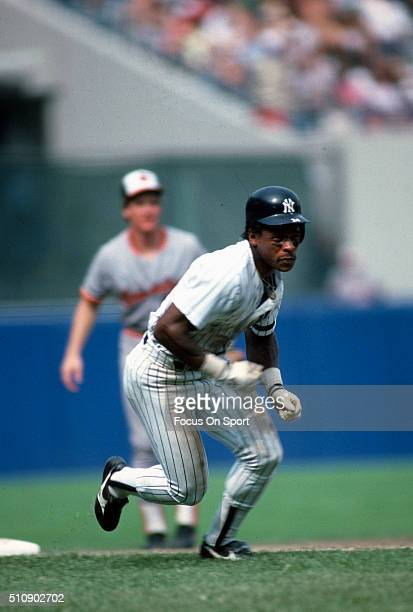 Outfielder Rickey Henderson of the New York Yankees leads off of third base against the Baltimore Orioles during an Major League baseball game circa...