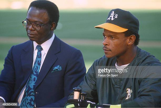Outfielder Rickey Henderson of the Oakland Athletics and former St Louis Cardinal Lou Brock being interviewed prior to the start of a Major League...