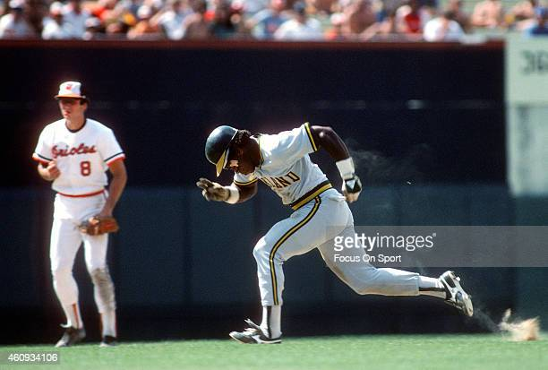 Outfielder Rickey Henderson of the Oakland Athletics attempts to steal third base against the Baltimore Orioles during an Major League Baseball game...
