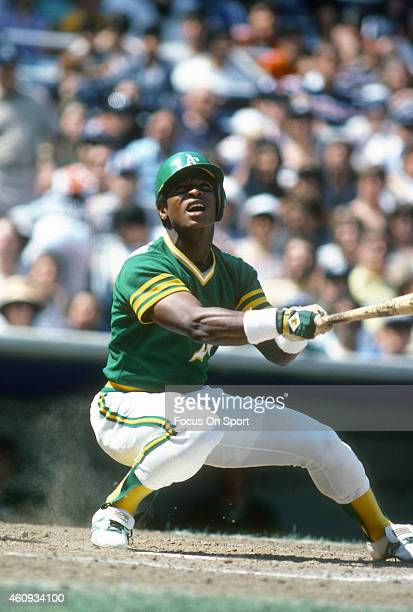 Outfielder Rickey Henderson of the Oakland Athletics bats against the New York Yankees during an Major League Baseball game circa 1980 at Yankee...