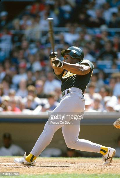 Outfielder Rickey Henderson of the Oakland Athletics bats bats against the New York Yankees during an Major League Baseball game circa 1994 at Yankee...