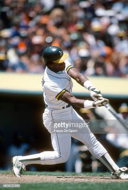 Outfielder Rickey Henderson of the Oakland Athletics bats during an Major League Baseball game circa 1982 at the OaklandAlameda County Coliseum in...