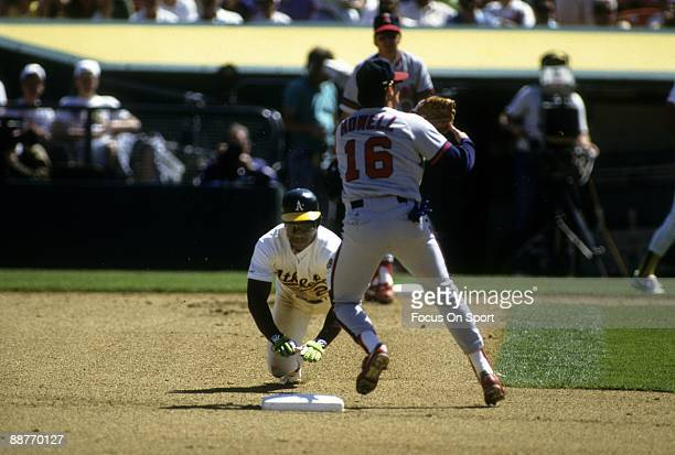 Outfielder Rickey Henderson of the Oakland Athletics dives into second base stealing it against the California Angles tying former St Louis Cardinals...