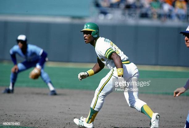 Outfielder Rickey Henderson of the Oakland Athletics leads off of first base against the Toronto Blue Jays during an Major League Baseball game circa...