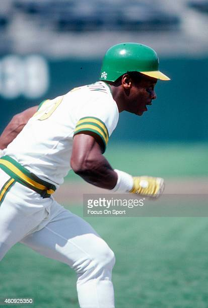 Outfielder Rickey Henderson of the Oakland Athletics runs down the first base line during an Major League Baseball game circa 1980 at the...