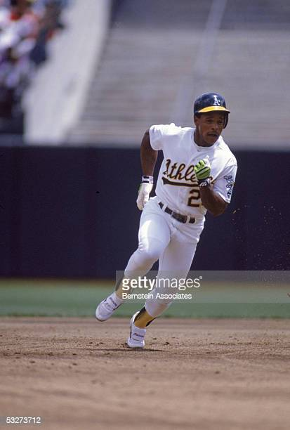 Outfielder Rickey Henderson of the Oakland Athletics runs during a May 1990 game at the OaklandAlameda County Coliseum in Oakland California
