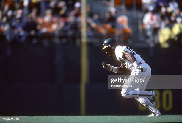 Outfielder Rickey Henderson of the Oakland Athletics runs the bases during an Major League Baseball game circa 1982 at the OaklandAlameda County...