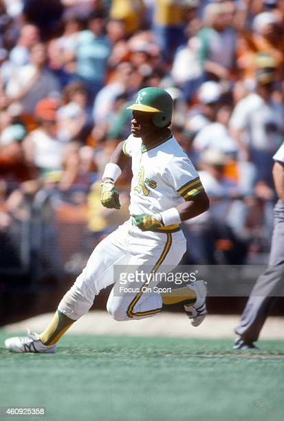Outfielder Rickey Henderson of the Oakland Athletics runs the bases during an Major League Baseball game circa 1981 at the OaklandAlameda County...
