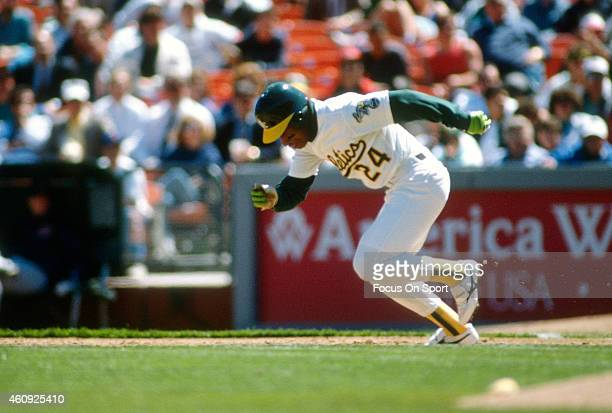 Outfielder Rickey Henderson of the Oakland Athletics runs the bases during an Major League Baseball game circa 1990 at the OaklandAlameda County...