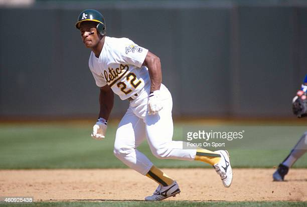 Outfielder Rickey Henderson of the Oakland Athletics runs the bases during an Major League Baseball game circa 1989 at the OaklandAlameda County...