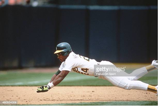 Outfielder Rickey Henderson of the Oakland Athletics steals third base against the New York Yankees during a Major League Baseball game May 1 1991 at...