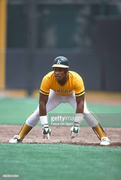 Outfielder Rickey Henderson of the Oakland Athletics takes his lead off of first base during an Major League Baseball game circa 1982 Henderson...