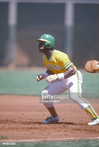 Outfielder Rickey Henderson of the Oakland Athletics takes his lead off of first base during an Major League Baseball game circa 1980 Henderson...