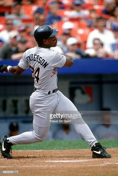 Outfielder Rickey Henderson of the San Diego Padres bats against the New York Mets during an Major League Baseball game circa 1996 at Shea Stadium in...