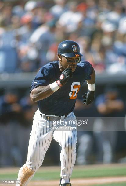 Outfielder Rickey Henderson of the San Diego Padres puts the ball in play and races up the first base line during an Major League Baseball spring...