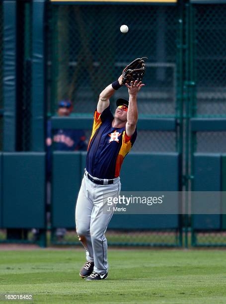Outfielder Robbie Grossman of the Houston Astros catches a fly ball against the Pittsburgh Pirates during a Grapefruit League Spring Training Game at...