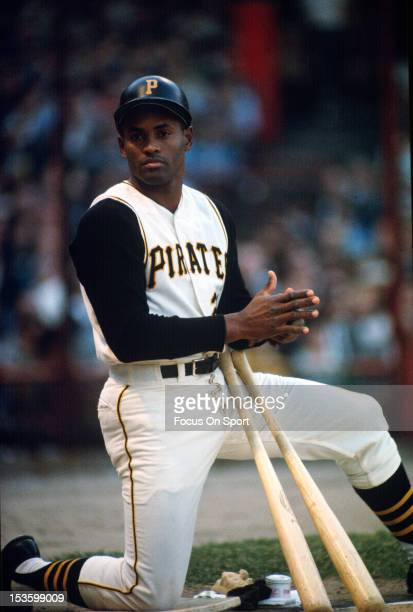 Outfielder Roberto Clemente' #21of Pittsburgh Pirates Kneels in the ondeck circle an looks on during an Major League Baseball game circa 1963 at...