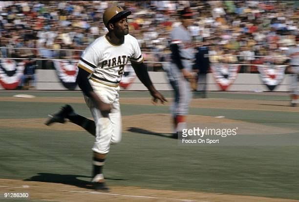 Outfielder Roberto Clemente of the Pittsburgh Pirates races down the first baseline against the Baltimore Orioles during the World Series October...