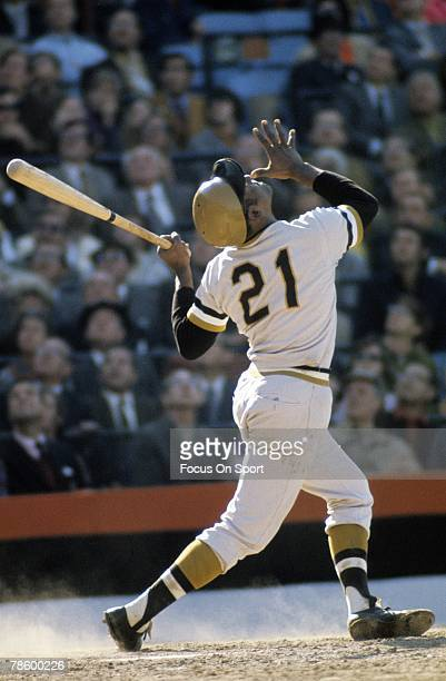 Outfielder Roberto Clemente of the Pittsburgh Pirates swings and watches the flight of his ball against the Baltimore Orioles during the World Series...