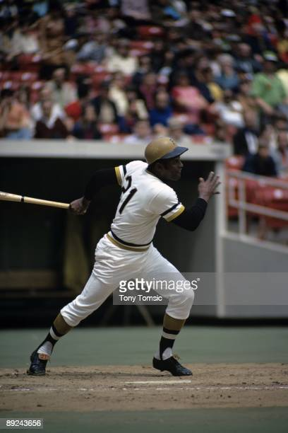 Outfielder Roberto Clemente of the Pittsburgh Pirates watches the ball he's hit towards rightfield during a game in 1972 at Three Rivers Stadium in...