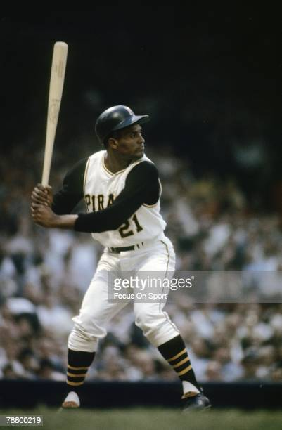 Outfielder Roberto Clemente Pittsburgh Pirates stands at the plate ready to hit during a MLB baseball game circa early 1960s at Forbes Field in...