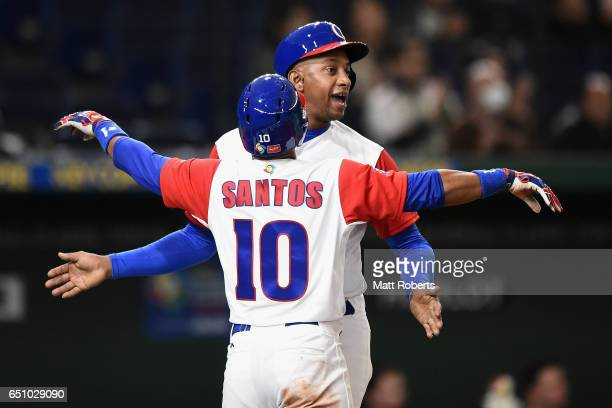Outfielder Roel Santos and Infielder Alexander Ayala of Cuba celebrate after a grand slam by Outfielder Alfredo Despaigne to in the bottom of the...