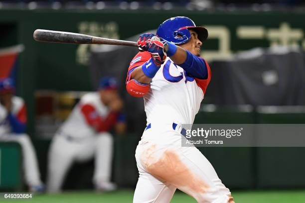 Outfielder Roel Santos of Cuba hits a tworun triple to make it 03 in the bottom of the fourth inning during the World Baseball Classic Pool B Game...