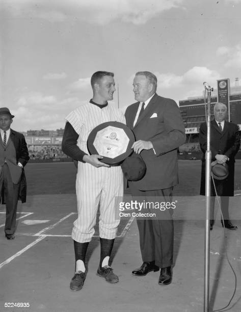 Outfielder Roger Maris, of the New York Yankees, is presented with the American league Most Valuable Player trophy for 1961 by American League...