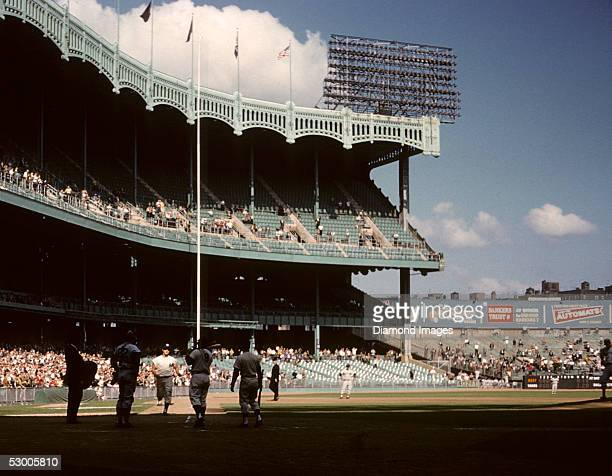 Outfielder Roger Maris of the New York Yankees rounds the bases after hitting his 61st home run of the season in a game on October 1 1961 against the...