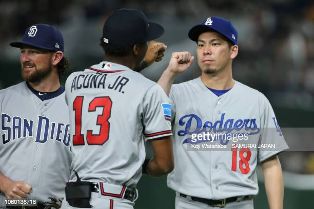 Outfielder Ronald Acuna Jr #13 of the Atlanta Braves and Pitcher Kenta Maeda of the Los Angeles Dodgers fist bump prior to the game three of Japan...