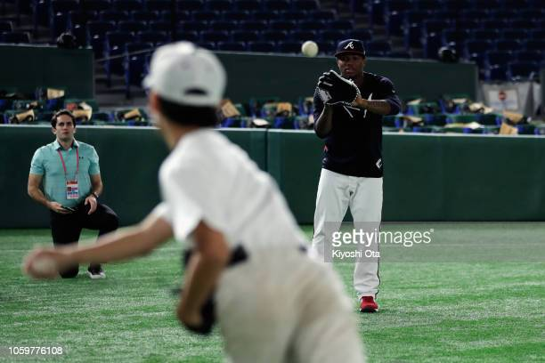 Outfielder Ronald Acuna Jr #13 of the Atlanta Braves attends the MLB Baseball Clinic prior to the game two of the Japan and MLB All Stars at Tokyo...