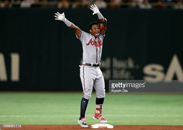Outfielder Ronald Acuna Jr #13 of the Atlanta Braves celebrates hitting a double in the top of the 1st inning during the exhibition game between...