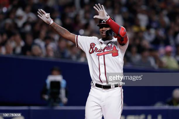 Outfielder Ronald Acuna Jr #13 of the Atlanta Braves celebrates after hitting a solo home run in the bottom of 8th inning during the game six between...