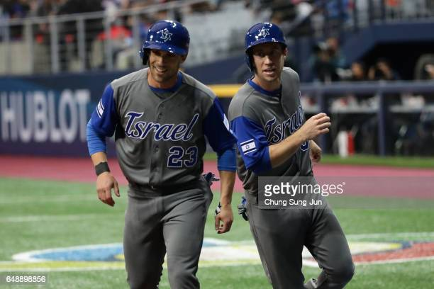 Outfielder Sam Fuld and Infielder Ty Kelly of Israel celebrate after scoring runs in the top of the first inning during the World Baseball Classic...