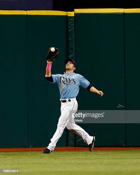 Outfielder Sam Fuld of the Tampa Bay Rays catches a fly ball against the San Diego Padres during the game at Tropicana Field on May 12 2013 in St...