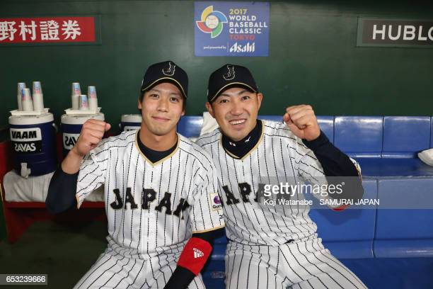 Outfielder Seiichi Uchikawa and Designated hitter Tetsuto Yamada of Japan pose for photographs after the World Baseball Classic Pool E Game Four...