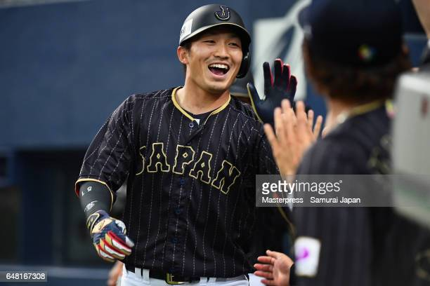 Outfielder Seiya Suzuki of Japan high fives with his team mates after hitting a threerun homer in the top of the second inning during the World...