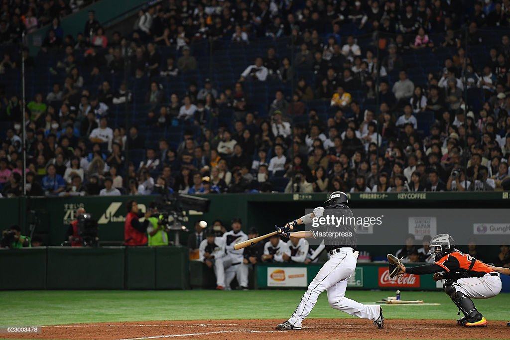 Outfielder Seiya Suzuki #51 of Japan hits a grand slam in the tenth inning during the international friendly match between Netherlands and Japan at the Tokyo Dome on November 13, 2016 in Tokyo, Japan.