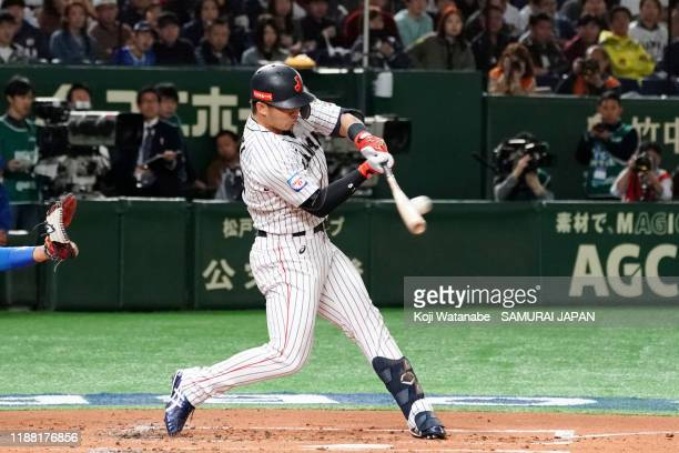 Outfielder Seiya Suzuki of Japan hits a RBI double in the bottom of 1st inning during the WBSC Premier 12 final game between Japan and South Korea at...