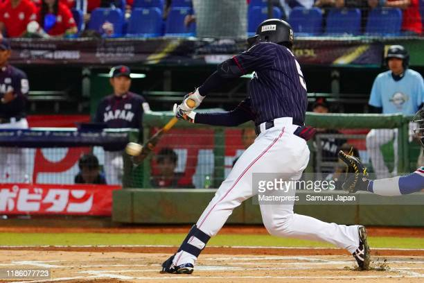 Outfielder Seiya Suzuki of Japan hits a RBI triple in the top of 1st inning during the WBSC Premier 12 Opening Round Group B game between Chinese...