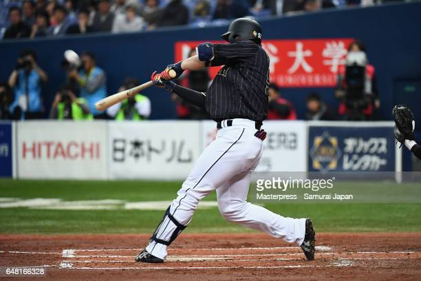 Outfielder Seiya Suzuki of Japan hits a threerun homer in the top of the second inning during the World Baseball Classic WarmUp Game between Japan...