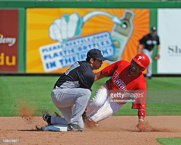 Outfielder Shane Victorino of the Philadelphia Phillies steals second base against the New York Yankees February 27 2011 at Bright House Field in...