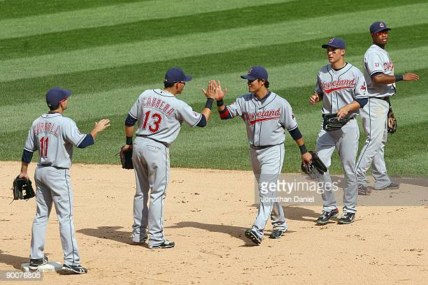 Outfielder Shin-Soo Choo of the Cleveland Indians celebrates with Asdrubal Cabrera after winning the game against the Chicago White Sox on August 9,...