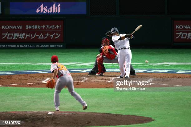 Outfielder Sho Nakata hits a RBI single in the bottom of the second inning during the World Baseball Classic First Round Group A game between Japan...