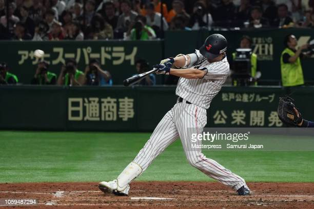 Outfielder Shogo Akiyama of Japan hits a three-run double in the bottom of 5th inning during the game one of the Japan and MLB All Stars at Tokyo...