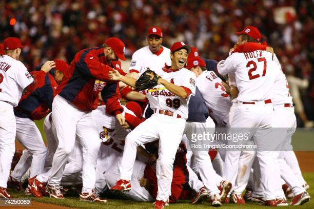 Outfielder So Taguchi of the St Louis Cardinals celebrates with his teammates on the field after defeating the Detroit Tigers in Game Five of the...
