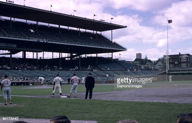 Outfielder Stan Musial of the St Louis Cardinals stands on firstbase after drawing a base on balls from pitcher Larry Jackson of the Chicago Cubs in...